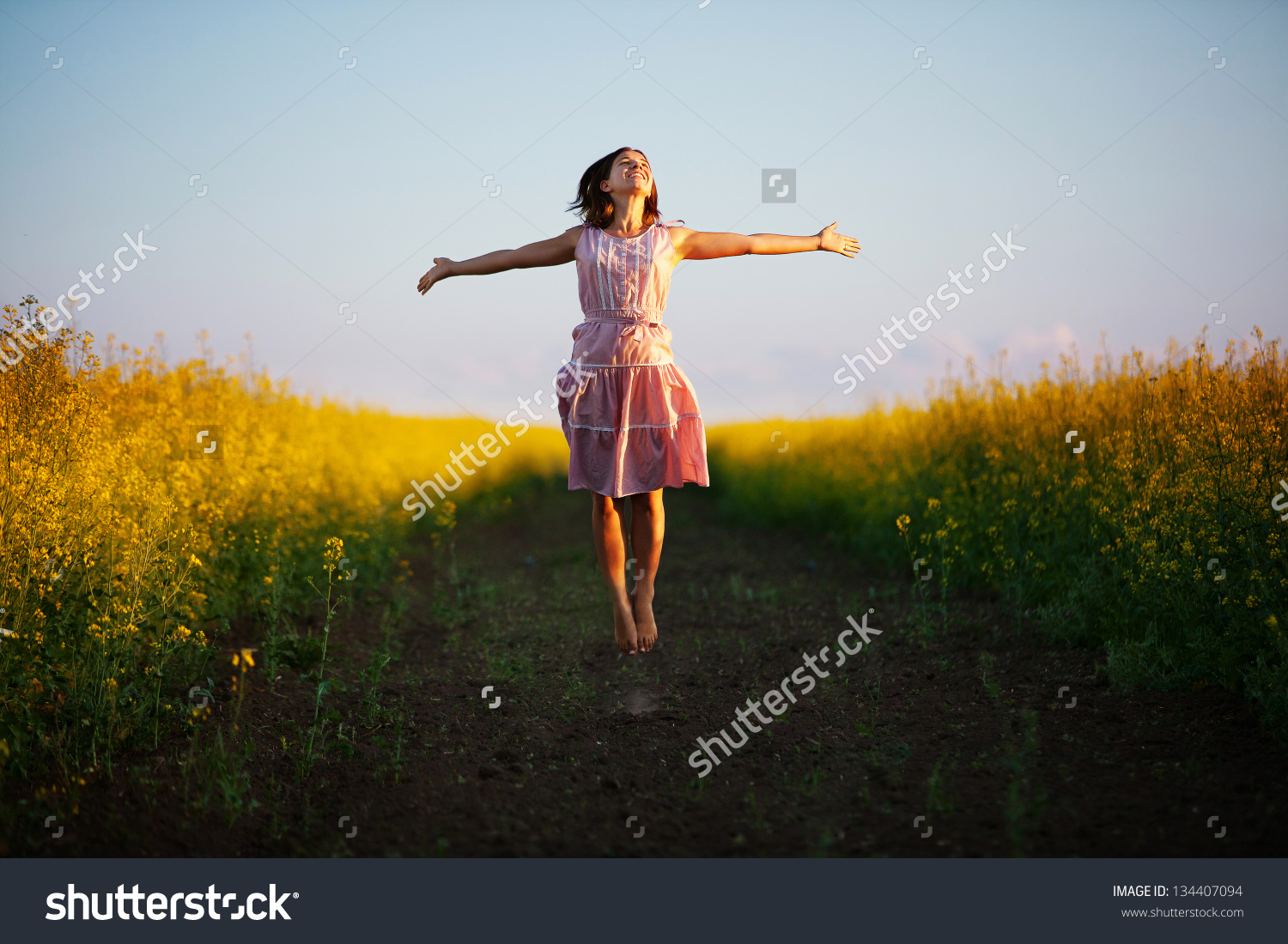 stock-photo-happy-woman-jumps-to-the-sky-in-the-yellow-meadow-at-the-sunset-134407094